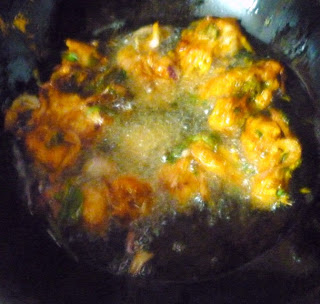 Deep frying Chicken Pakoda